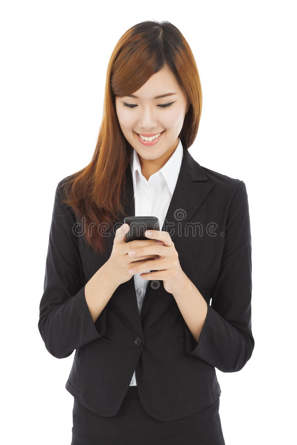 Asian young business woman touching mobile phone royalty free stock photos
