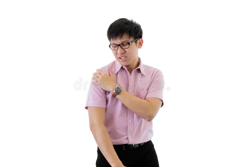 Asian young businessman has standing with shoulder ache on isolated on wihte background. Adult arms black body brown caucasian employee excited expression stock photos