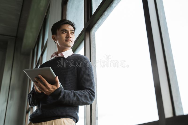 Asian young businessman using tablet pc stock image