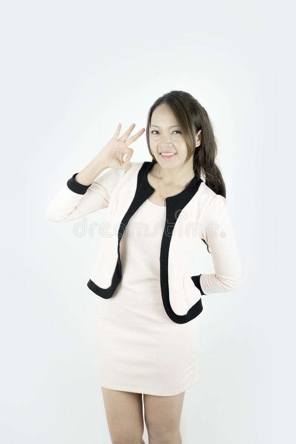 Asian Businesswoman showing OK hand sign smiling happy. stock photos