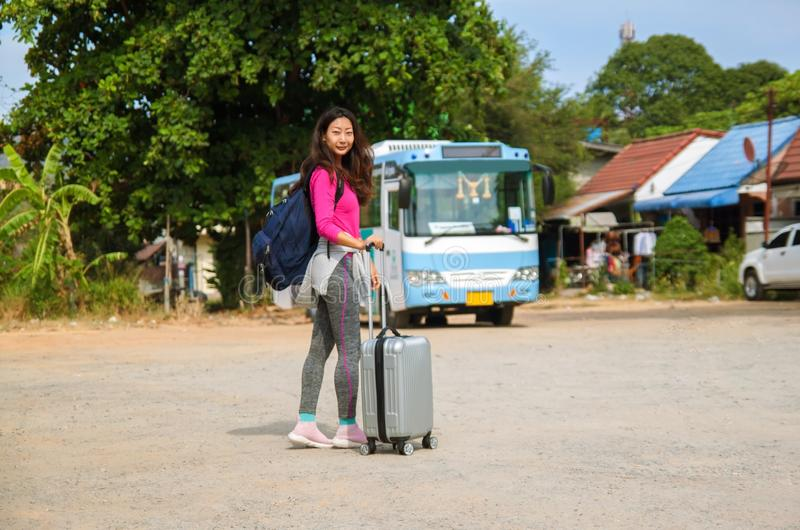 Asian young cheerful woman traveling by bus . stock image