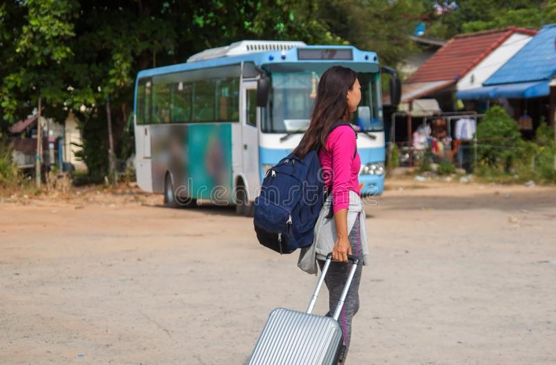 Asian young cheerful woman traveling by bus . royalty free stock photography