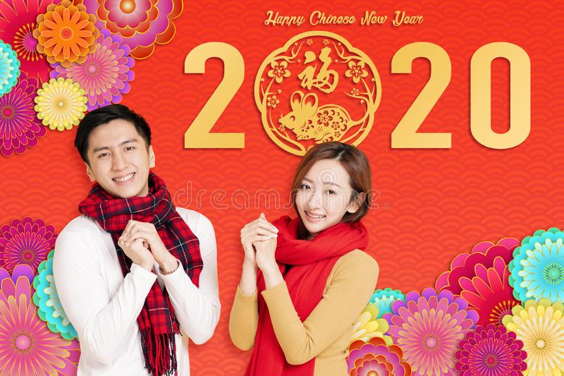 Asian young couple celebrating for chinese new year. chinese text happy new year 2020.  royalty free stock photography
