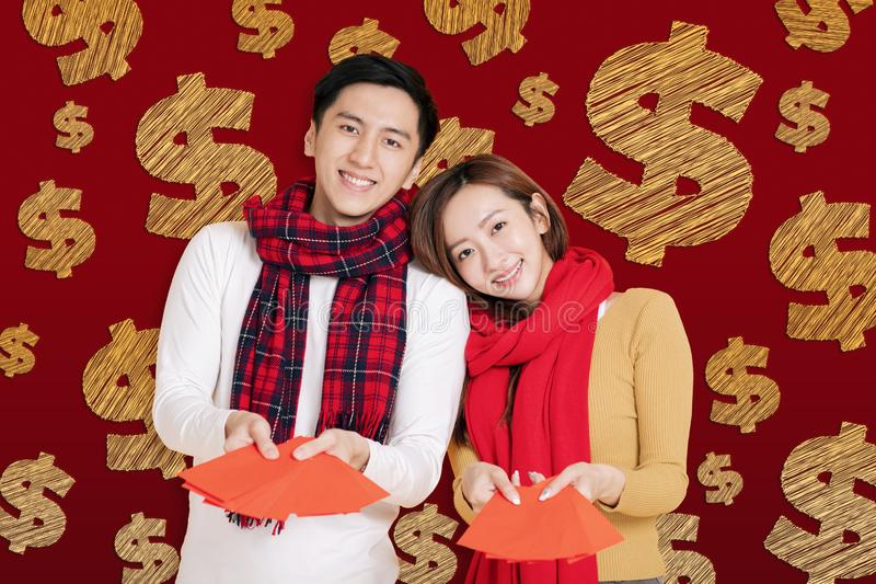 Asian young couple celebrating for chinese new year. chinese text happy new year 2020.  royalty free stock image