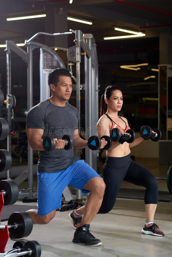 Lunges with weights stock images
