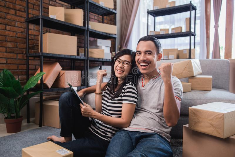 Market place online seller concept. Asian young couple entrepreneur with packages at home. market place online seller concept royalty free stock images