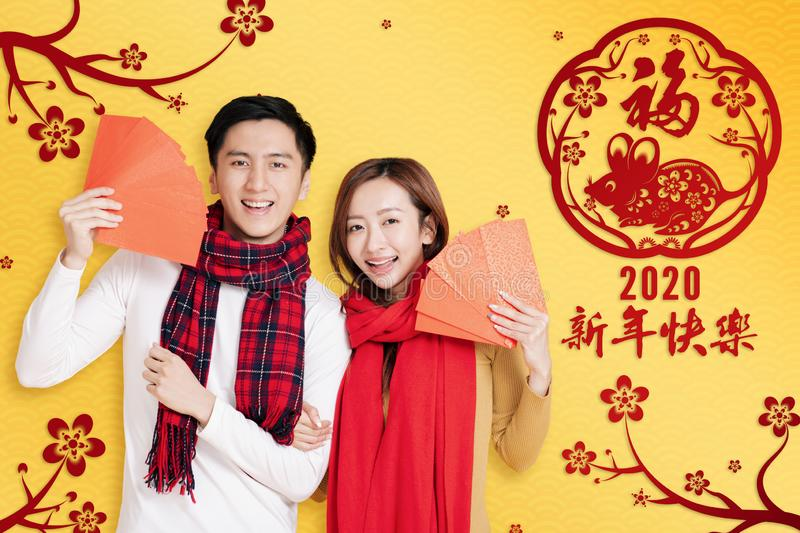 Asian young couple showing red envelopes for chinese new year.chinese text happy new year 2020.  stock images
