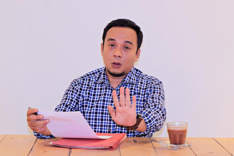 Asian young entrepreneurs say NO hand gesture -concept movement for bribery in employment acceptance stock photos