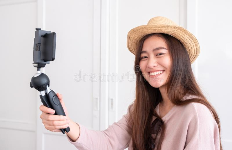 Asian young female blogger recording vlog video with mobile phone live streaming when travel.online influencer on social media vi royalty free stock photos