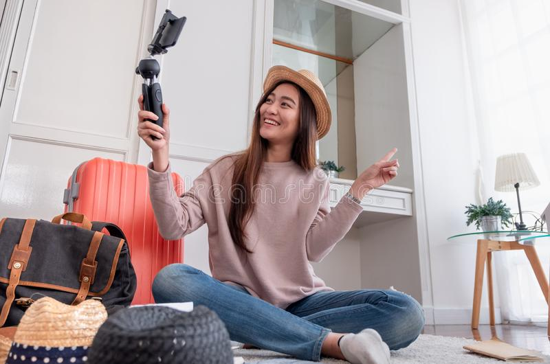 Asian young female blogger recording vlog video with mobile phone live streaming when travel.online influencer on social media vi royalty free stock images