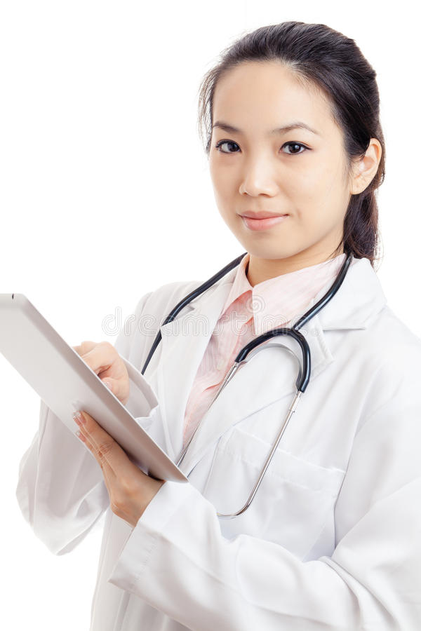Asian young female doctor using tablet. Isolated on white royalty free stock photos