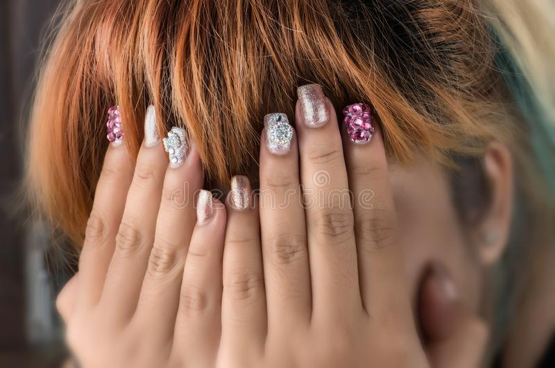 Asian young girl homemade fasion nail by oneself. royalty free stock image