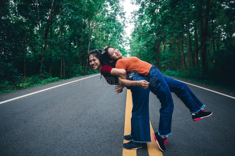 Asian young girl on a piggy back ride with her sister, natural travel concept. Cute Asian young girl on a piggy back ride with her sister, natural travel concept royalty free stock images