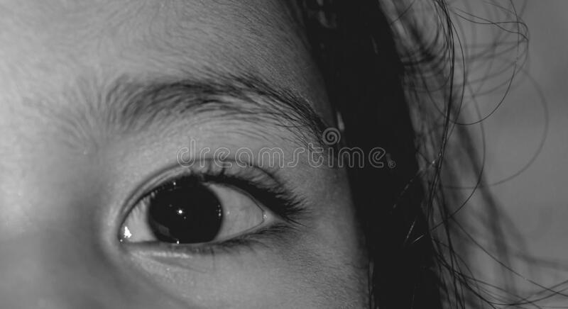 Asian young girl`s eye. Black and white stock photo