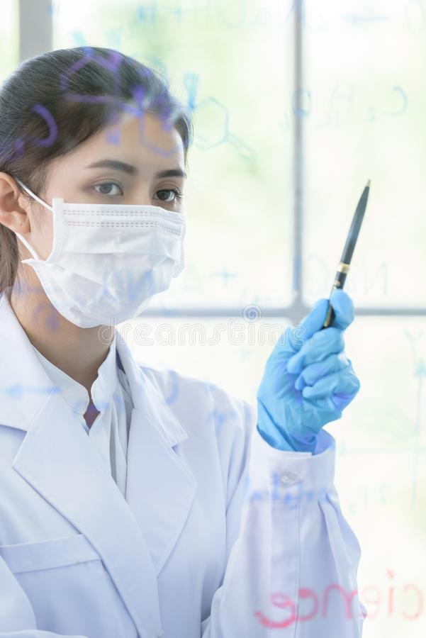 Asian young girl student scientist has writing and researching in laboratory stock images