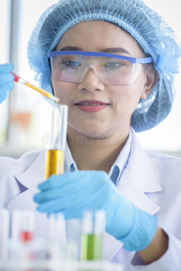 Asian young girl student scientist researching  and learning in a laboratory stock images