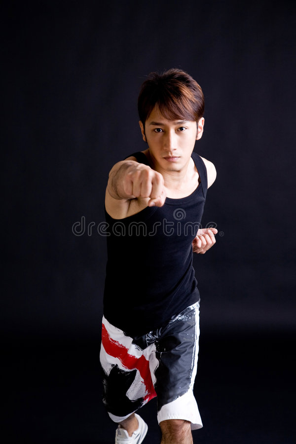 Download Asian Young Guy Give A Punch Stock Image - Image: 6961683
