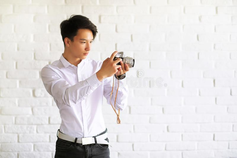 Asian young man with a camera stock photo