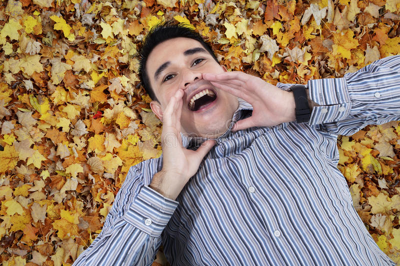 Download Asian Young Man Shouting On Leaves Stock Photo - Image of emotion, adult: 33725150