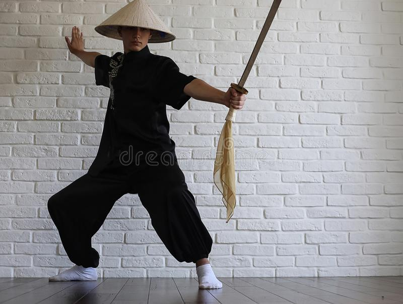 Asian young novice on a white brick wall royalty free stock photography