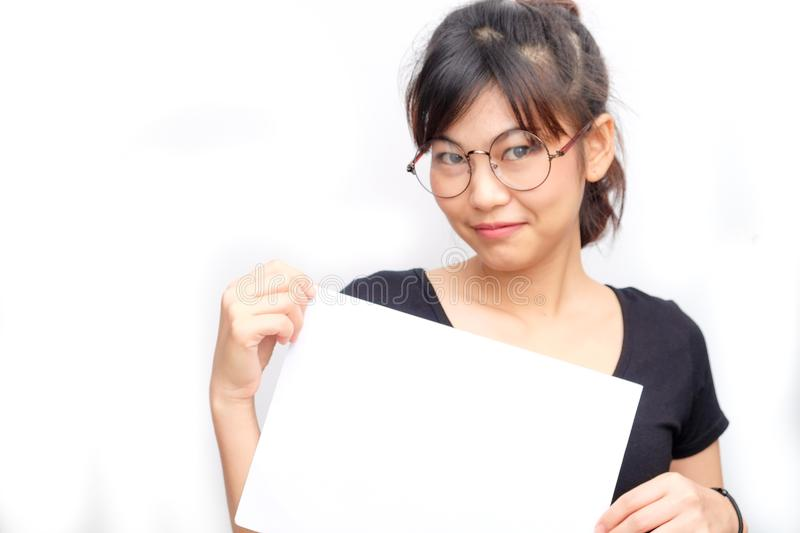 Asian young smiling woman holding blank business paper card royalty free stock photo