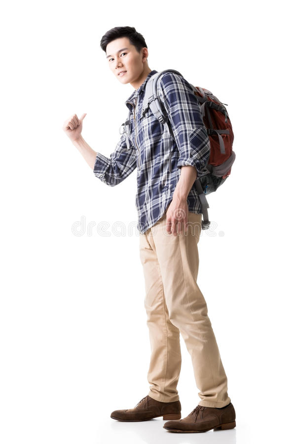 Asian young traveling man hitchhiking stock photo