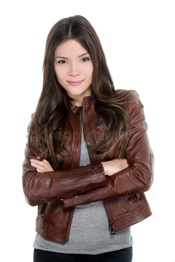 Asian young woman casual moto bike leather jacket portrait isolated on white background. Happy confident model with royalty free stock photo