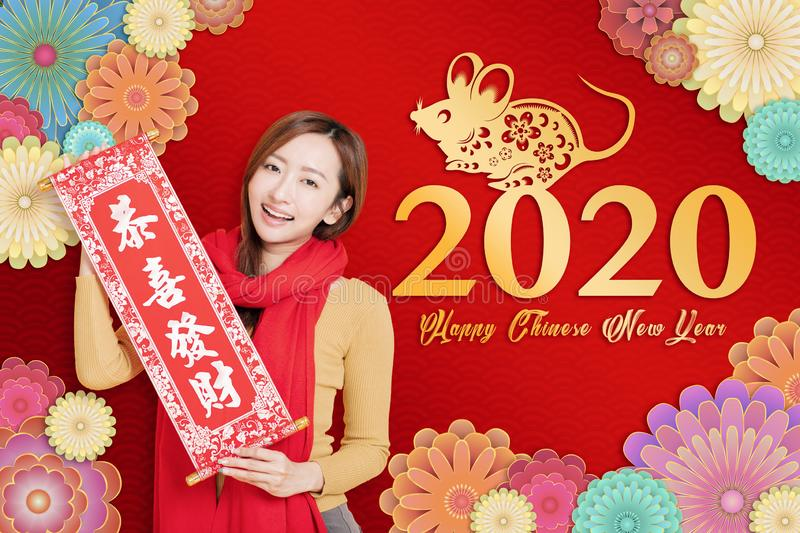 Asian young woman celebrating for chinese new year. chinese text happy new year 2020.  royalty free stock photos