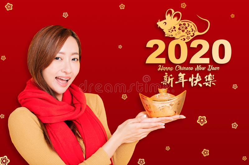 Asian young woman celebrating for chinese new year. chinese text happy new year 2020.  stock photo