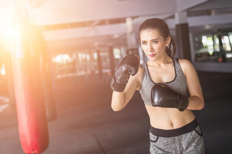 Asian young woman doing exercise with Thai boxing Muay Thai eq royalty free stock image