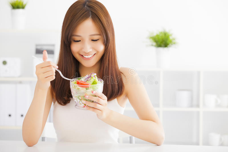 Asian young woman eating healthy food. Beautiful asian young woman eating healthy food stock photography