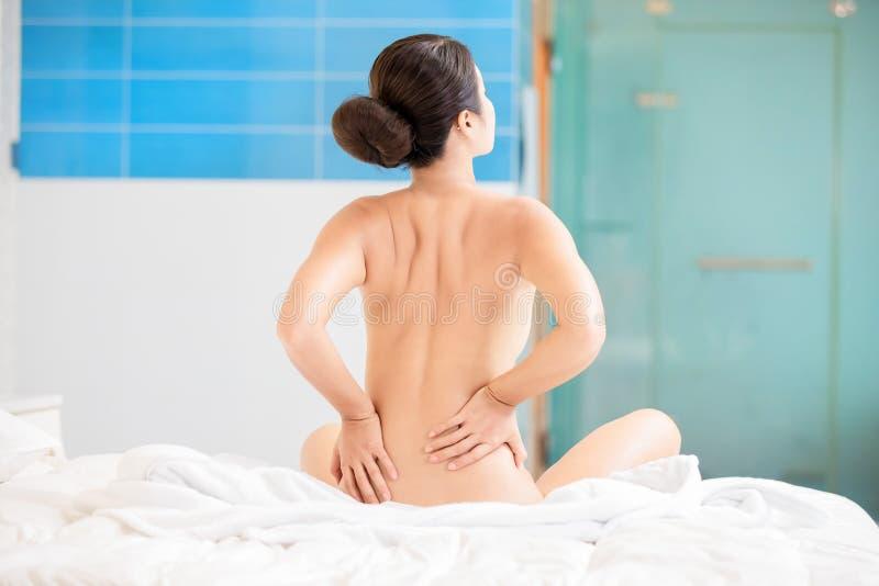 Asian woman has lumbago stock images