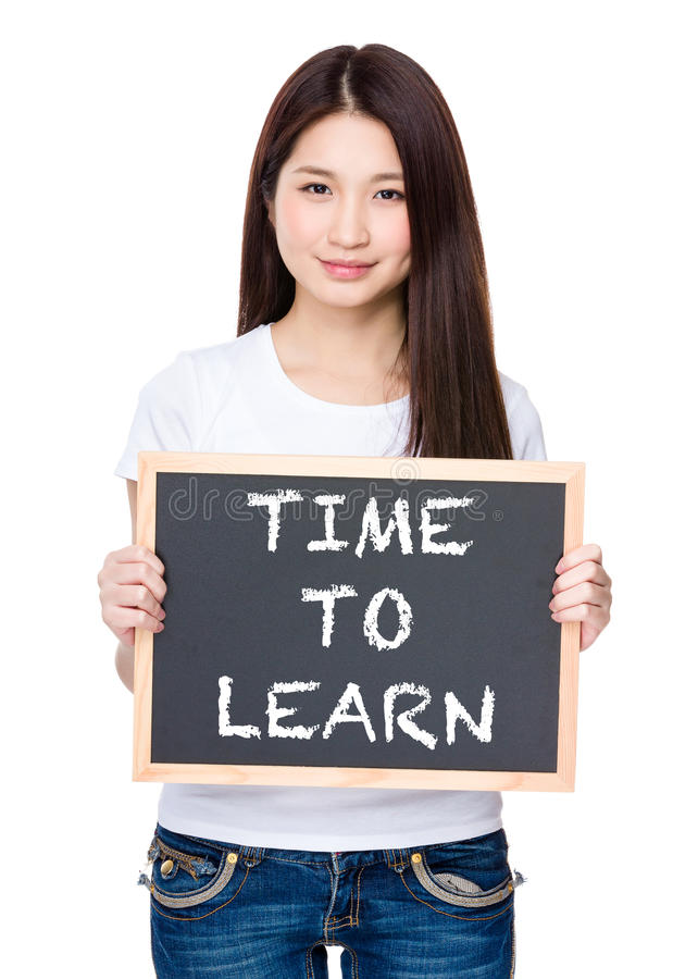Asian young woman hold with chalkboard showing phrase of time to royalty free stock photos