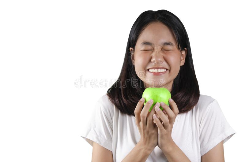20 an Asian young woman holding a green apple with the white background stock images