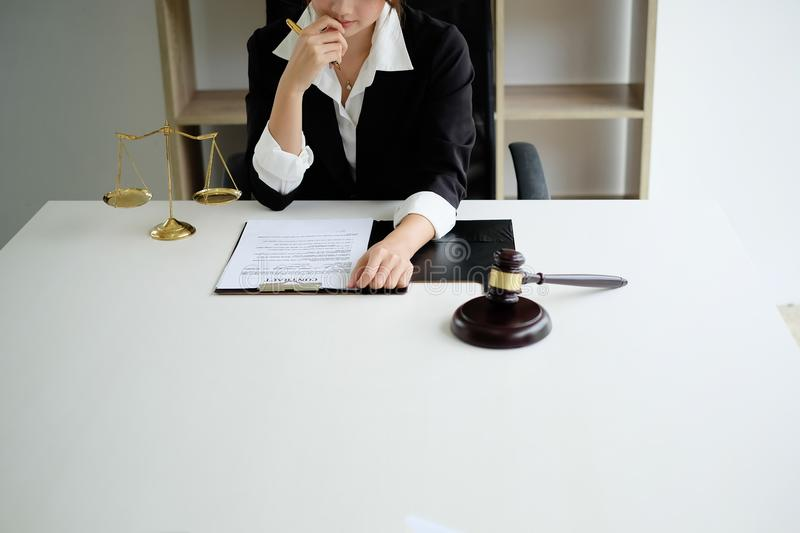 Asian young woman  lawyer who is currently working on financial stock images