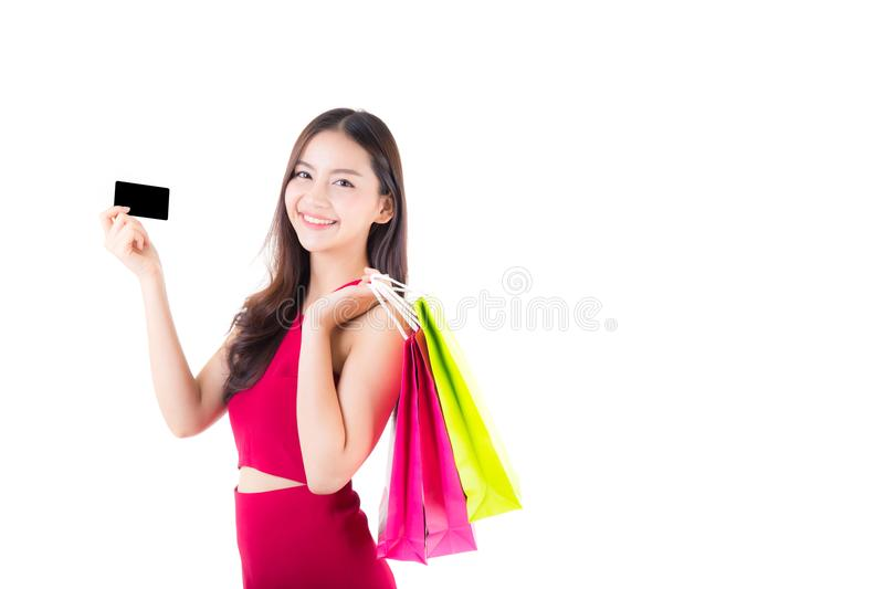 Asian young woman with red dress holding a credit card and bag paper colorful isolated. On white background stock image