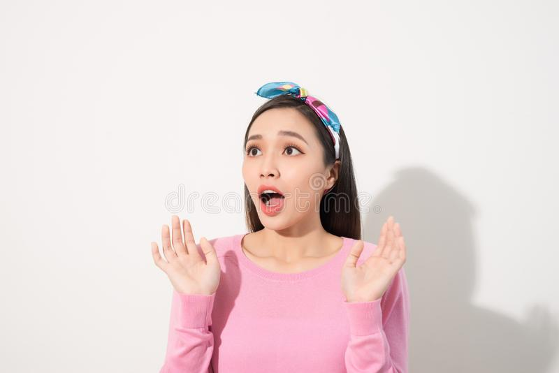 Asian Young Woman in Surprising Emotion, Face Look up above with opened mouth and hands, Emotional of Female Concept, Front view stock photography