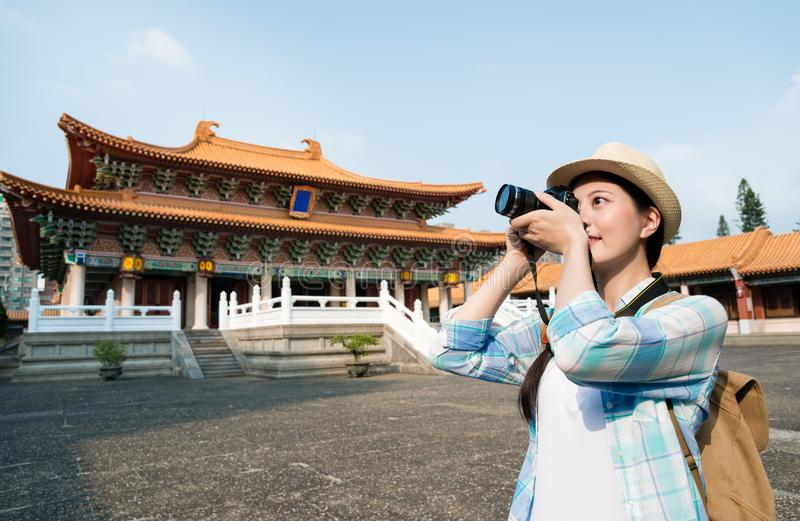 Asian young woman taking the photo stock photography