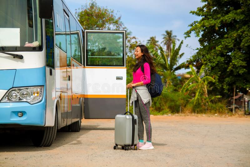 Asian attractive woman traveler getting on the tourist bus for travel. stock photography