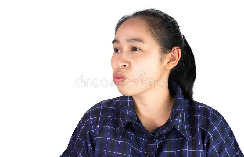 Asian young woman uses the tongue to clean the teeth due to food scraps attached to the teeth, Isolated on white background stock image
