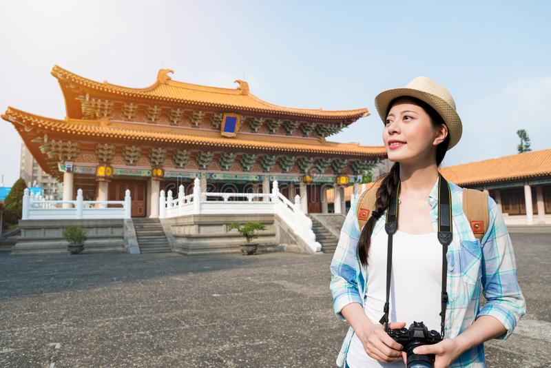 Asian woman visiting the Confucius temple royalty free stock photo