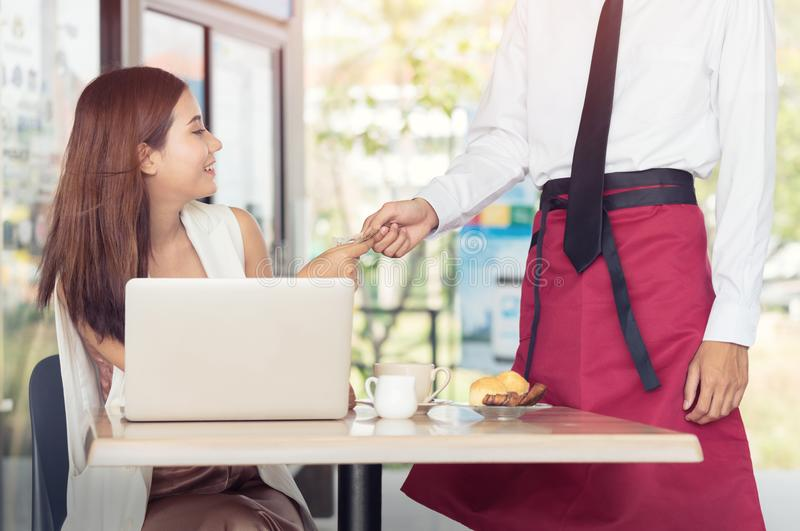 Asian young woman paying money at restaurant, people and service royalty free stock photography