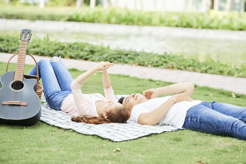 Couple relaxing outdoors stock photography