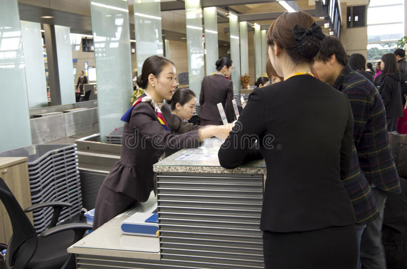 Asiana Airlines check-in counter at Incheon airpor. Beautiful and young girls of Asiana Airlines were helping passengers to check in at Incheon Airport, Seoul stock photos