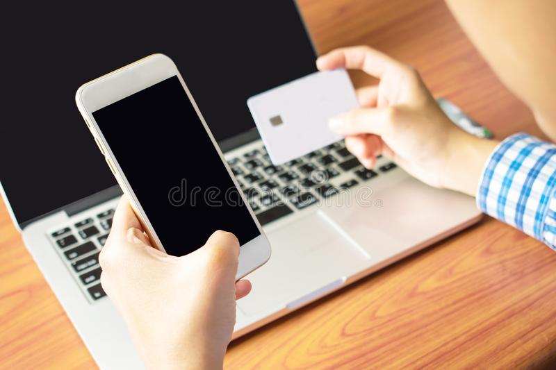 Asians are paying by credit card. Asians are paying by credit card royalty free stock photo