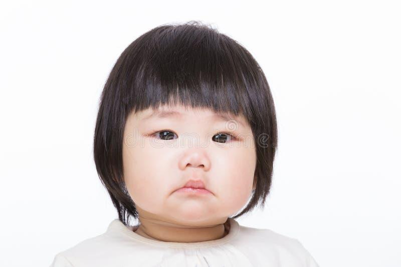 Asiatet behandla som ett barn flickan arkivfoton