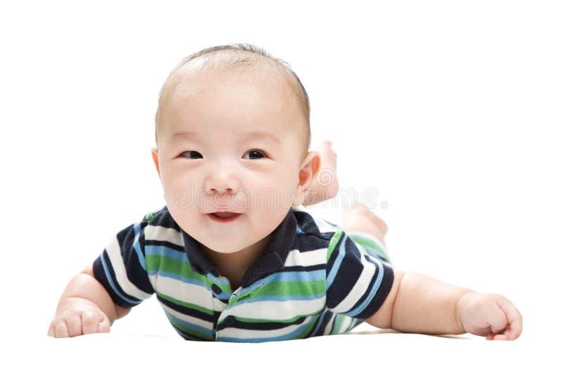 asiatet behandla som ett barn pojken arkivbild