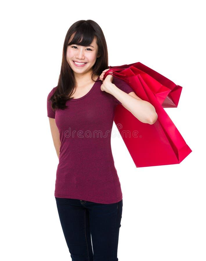 Asiatingriff mit Einkaufstasche stockbilder