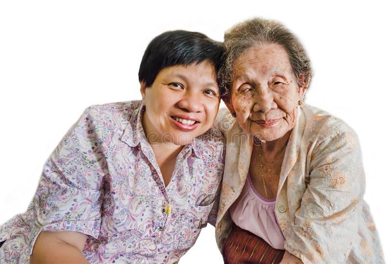 Asiatische Ältestmutter und -tochter isoliert stockfotografie