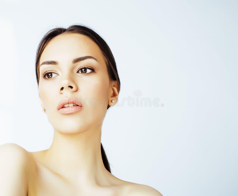 Asiatische Frau der Junge recht mit den Händen auf dem Gesicht lokalisiert auf weißem Hintergrund, stilvolles Modegesundheitswese stockfoto